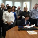 Raimondo Signs Legislation Raising Minimum Wage in Rhode Island